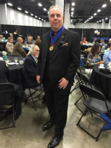 """Hypnotist John Cerbone was awarded the Awarded the prestigious """"Order of the Braid"""" at the NGH International Conference on August 12, 2016.  Order of Braid Council: The Order of Braid designation is the centerpiece of the NGH Awards System and recognizes a lifetime of outstanding achievement, dedication, and service. Initials used for this designation are OB."""